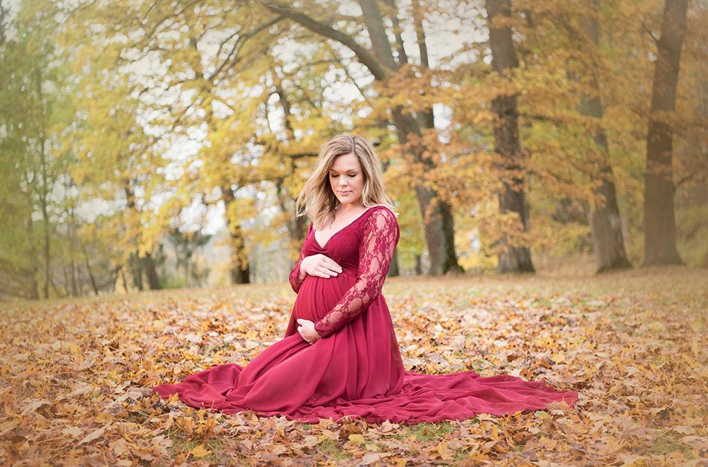 vin röd gravid fotografering höst